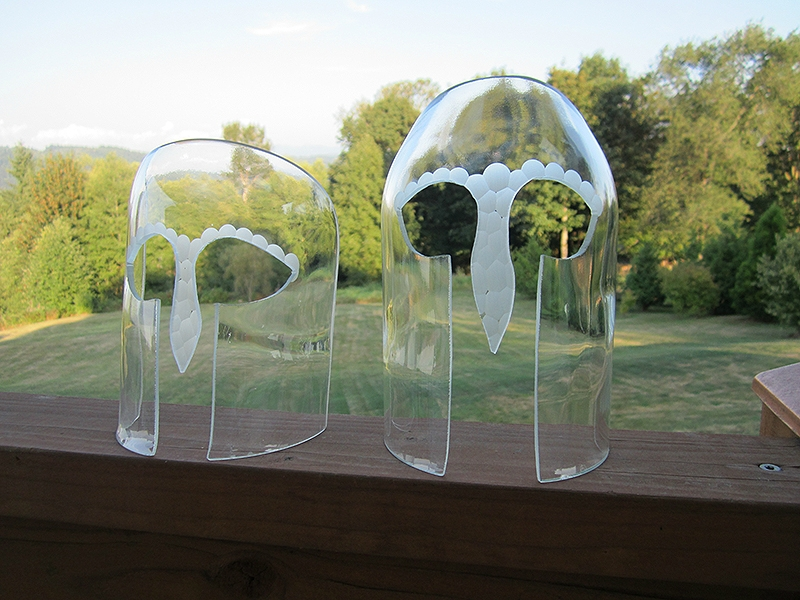 2 untitled glass masks- Battuto type glass engraving on cut & ground bottle glass