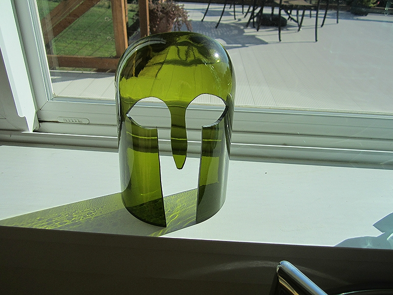 Untitled glass mask- cut & ground bottle glass